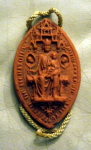 The obverse side of the seal of Merton Priory, engraved in 1241. (Replica impression of a seal at the British Museum.)