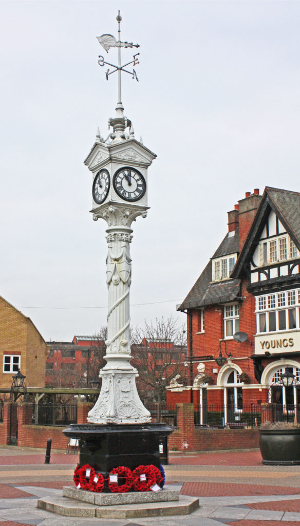 Mitcham Clock Tower, Mitcham Upper Green, Mitcham CR4. Erected in 1898 to commemorate the Diamond Jubilee of Queen Victoria, replacing the Village Pump. Moved to its current position in 1994