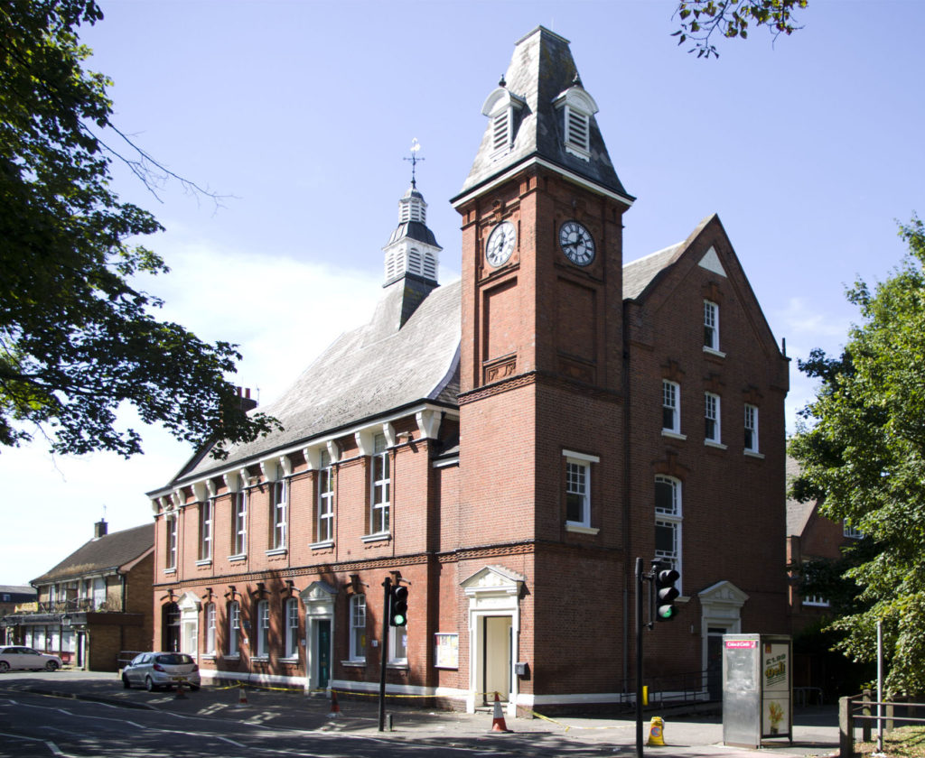 The Vestry Hall, London Road, Mitcham CR4. This council-owned building now houses volunteer and charitable organisations. It was built in 1887 on a site used from 1765 as a 'Watch House' or gaol. This earlier building, after its use as a prison had ceased, was converted to house the hand-operated fire engine.