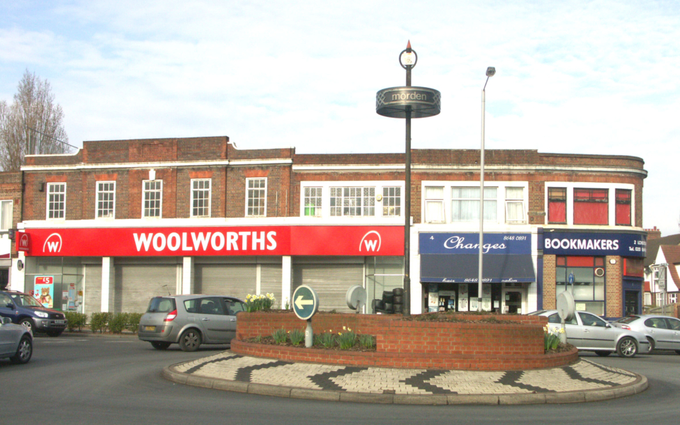 London Road / Morden Road Roundabout, Morden, Surrey SM4. Woolworths with new-style fascia (closed later in year with end of company)
