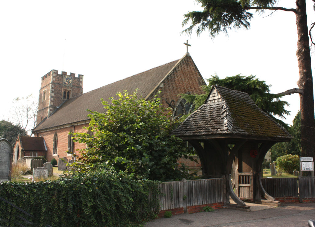 Church of St Lawrence, Epsom Road, Morden SM4. The 1630s' exterior of the Church (1630s) and the Lych Gate, a WW1 memorial.