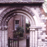 Norman Arch from Merton Priory in churchyard of St Mary