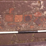 Medieval floor tiles from Merton Abbey, Moved to Ravensbury Park.