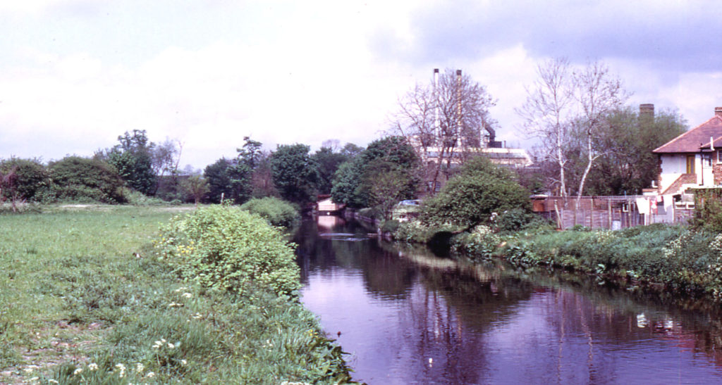 River Wandle above Liberty's, Merton, London SW 19. From Windsor Avenue.
