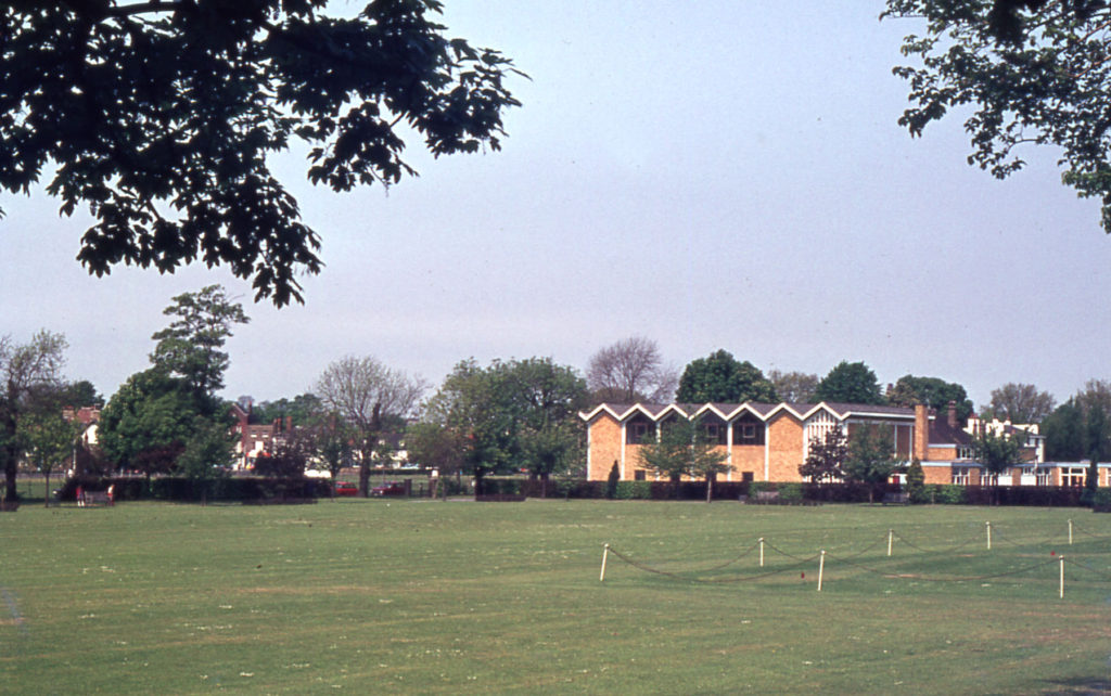 The Canons front lawn, The Canons, Madeira Road, Mitcham, Surrey CR4. Gifted c. 1150 by the parishioners of Mitcham to the Augustian canons at Southwark Priory. Mitcham Methodist Church beyond.