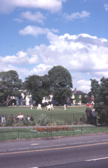 Cricket match on Lower Green, Mitcham, Surrey CR5.