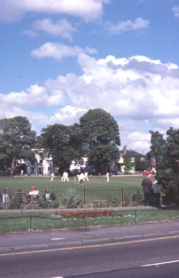 Cricket match on Lower Green, Mitcham, Surrey CR5.