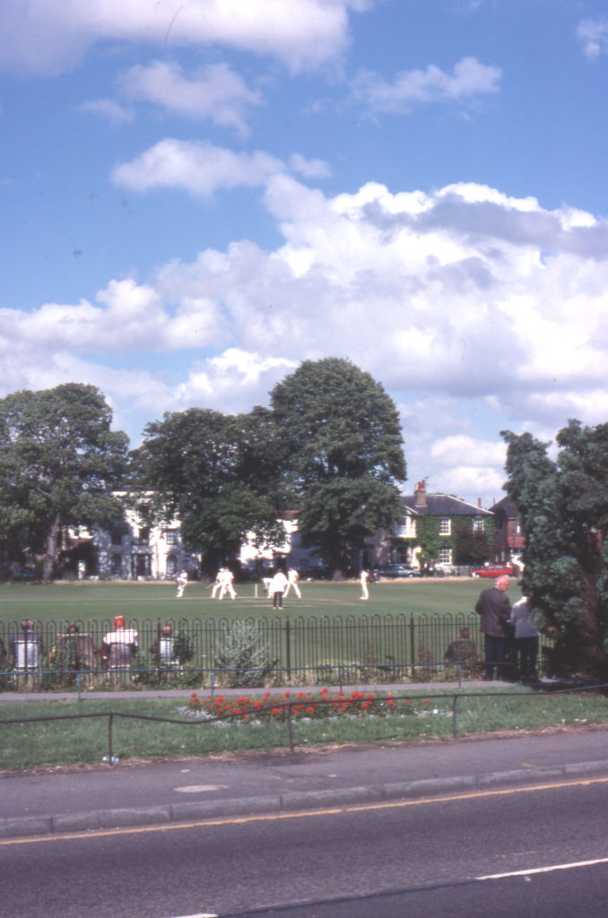 Cricket match on Lower Green, Mitcham, Surrey CR4.
