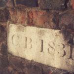 9 Cricket Green, Mitcham, Surrey CR4. Dated (1831) stone in garden wall.