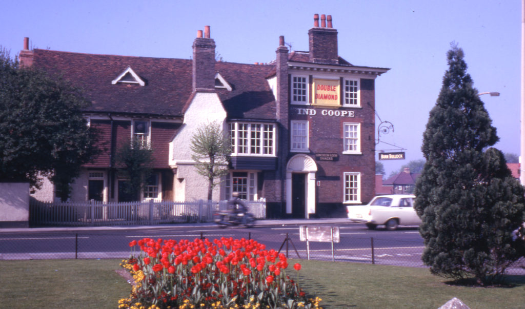 The Kings Head, 315 London Road, (at Mitcham Cricket Green), Mitcham, Surrey CR4. Looking south-west from edge of Cricket Green. Rear (on left) dates from late 16th or early 17th century. The front (right) os 1760. In 1975 re-named Burn Bullock.