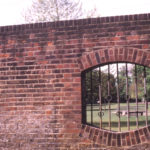 Location of boundary tablet on wall of Wandle Park, Colliers Wood, London SW19. Byegrove Road. rear of Newborough Court.