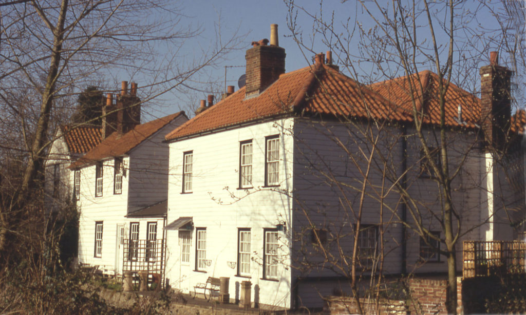 Mill Cottages from Watermeads, Mitcham, Surrey CR4. Nos. 475-479 (right) London Road.