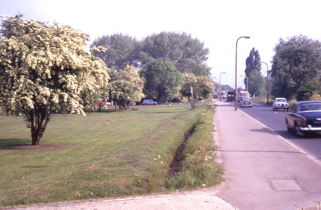 Junction of Carshalton Road and Arnies Lane, Mitcham Common, Mitcham, Surrey CR4. Looking north.