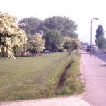 Junction of Carshalton Road and Arnies Lane, Mitcham Common, Mitcham, Surrey CR4. Looking north.