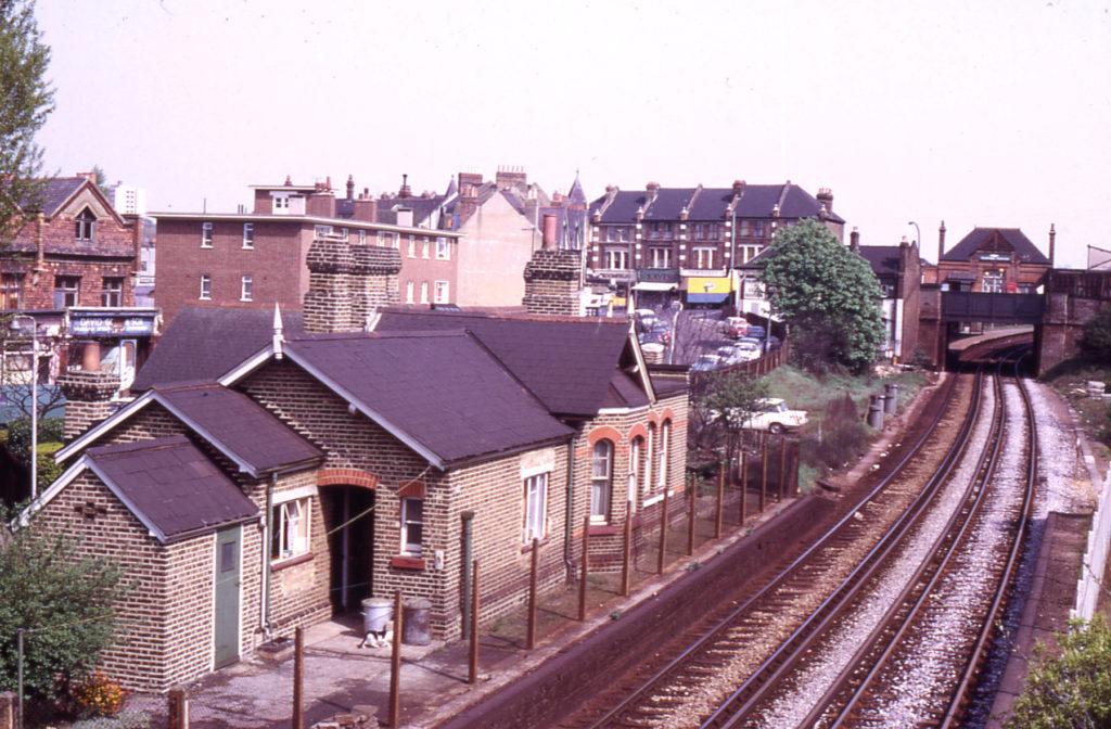 Tooting Station, London SW17. Seen from footbridge to Longley Road. Opened in 1894. River Graveney (ancient parish boundary) and Little Graveney meet near footbridge