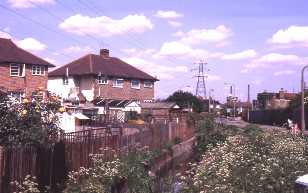 Phipps Bridge Road and Merton/Mitcham boundary ditch, Mitcham, Surrey CR4. Looking north east.