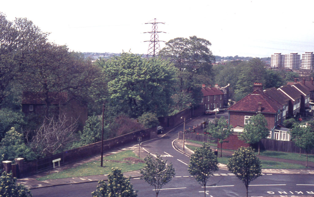 Grounds of Wandle Villa and Phipps Bridge Road from Council flats, Mitcham, Surrey CR4.