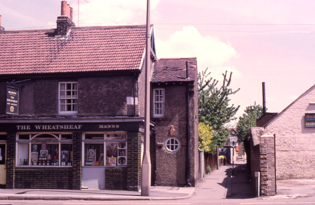 The Wheatsheaf (off-licence) and Fox's Path, Church Road, Mitcham, Surrey CR4. Wheatsheaf (Eric Ives). By 1979 the Wheatsheaf was isolated. having survived the demolition of adjoining houses.