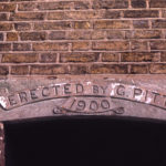 Dated stone on cottages in Century Road, Mitcham, Surrey CR4.