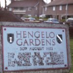 Plaque at Hengelo Gardens, Mitcham, Surrey CR4. Plaque unveiled 30 August 1952 by the Burgomaster of Hengelo (The Netherlands).