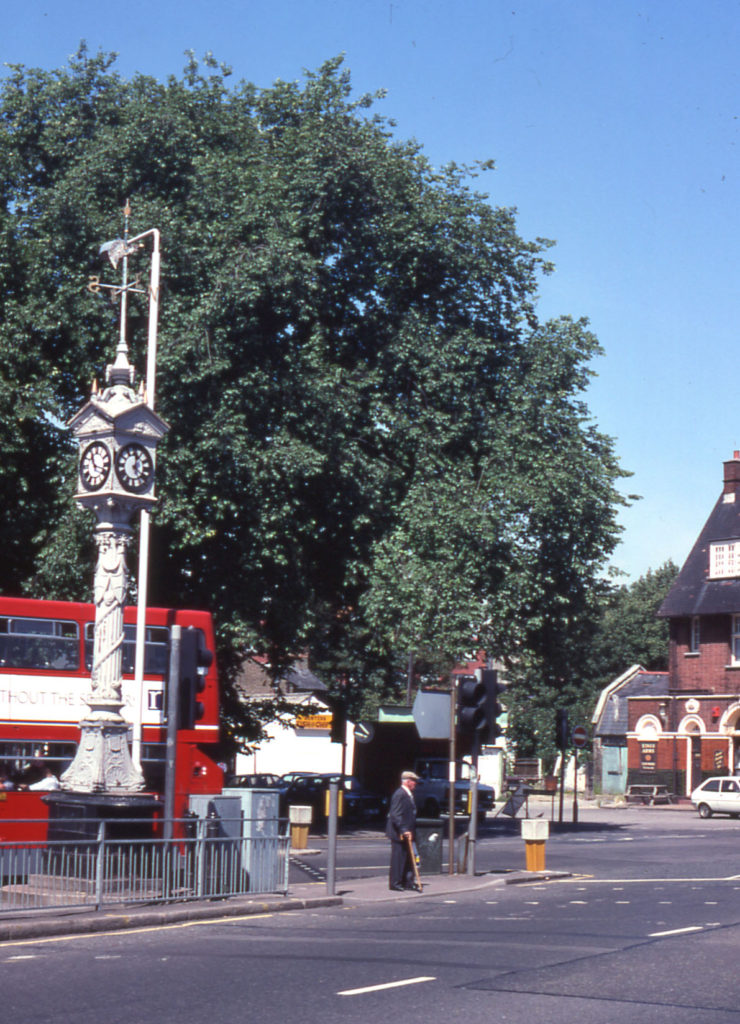Upper Green, Mitcham, Surrey CR4. The clocktower (left) was moved in 1994 to stand in the newly-pedestrianised area on the north-eastern side of the Upper Green.