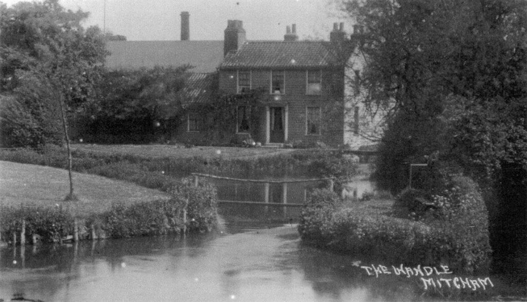 'The Wandle, Mitcham'. Mill cottages above Mitcham Bridge. Undated postcard.