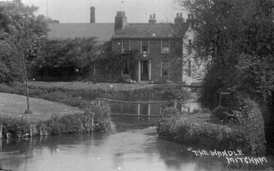 'The Wandle, Mitcham'. Mill cottages above Mitcham Bridge. Undated postcard.